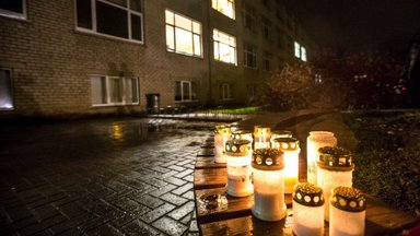 PHOTOS: people leave flowers, candles in front of the school